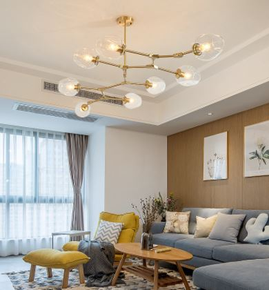 Dekorasi Ruang Keluarga Minimalis Dengan Lampu Kuningan